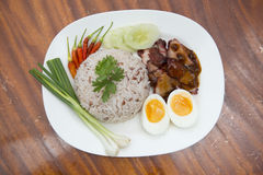 Rice with roasted red pork and egg Stock Photo