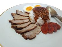 Rice with roasted red pork. And boiled egg and Chinese sausage served with stewed gravy sauce Stock Image