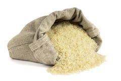 Rice rozlewał z torby Fotografia Stock