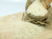 Rice in sack on choping broad. Rice sack and choping broad on white background Royalty Free Stock Image