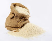 Rice in a sack and spilled Stock Photo