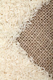 Rice on sackcloth background. Macro shot royalty free stock image