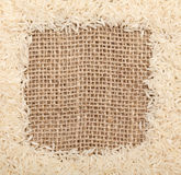 Rice on sackcloth frame. Close-up with macro lenses Stock Photography