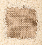 Rice on sackcloth frame Royalty Free Stock Photo