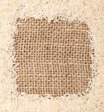 Rice on sackcloth frame. Background, studio shot with macro lenses royalty free stock photo