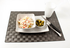 Rice salad. With olives on a white background Stock Photos