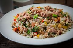 Rice salad on bowl. Assorte rice salad with vegetables on white plate Royalty Free Stock Photography