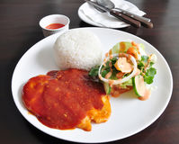 Rice, salad, and chicken with BBQ sauce. A plate of rice, salad, and chicken breast with barbecue sauce Stock Photo