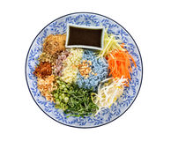 Rice salad with herbs and sauce on plate isolated Stock Image