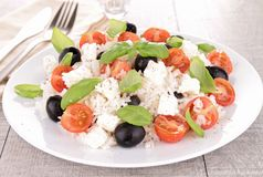 Rice salad with tomato,feta and basil Stock Photos