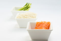 Rice salmon and sliced cucumber in white dish and white background Stock Images