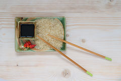 Rice, sauce, chopsticks, hot pepper. The plate dry foods for cooking rice Stock Photography