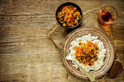 Rice with sauce of eggplant, peppers and tomatoes Stock Images