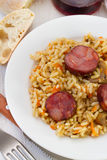 Rice with sausages and pork Stock Photos