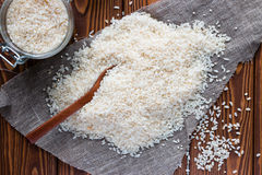 Rice scattered near the banks of rice on a napkin Royalty Free Stock Images