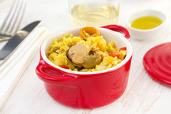 Rice with seafood in red small bowl Stock Photo
