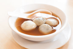 Rice and sesame dumpling in ginger syrup Royalty Free Stock Photos