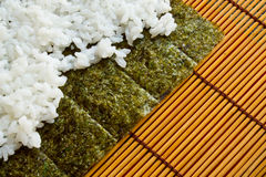 Rice on the sheet of sashimi Royalty Free Stock Photos