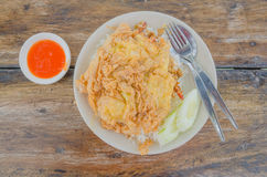 Rice , shrimp and omelet it's popular traditional Thai style food on wooden table with chili sauce Stock Photo