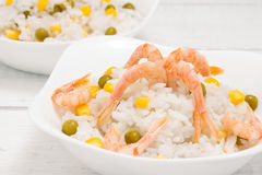 Rice with shrimp, peas and corn. Selective focus. Rice with shrimp, peas and corn on a white piece of old Board. Selective focus Stock Photography