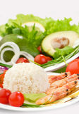 Rice, shrimps and vegetables on white dishes Royalty Free Stock Photos