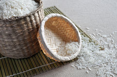 Rice in small baskets. Rice contained in small baskets sitting on a bamboo mat Stock Photography