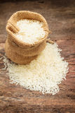 Rice in small burlap sack. Royalty Free Stock Photo