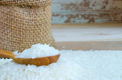 Rice in small hemp sacks and in wooden spool Stock Images