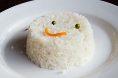 Rice smile on dish. Rice smile on white dish Stock Photos