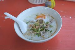 Rice soup or Congee minced pork and entrails with egg royalty free stock photography