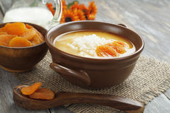 Rice soup with dried apricots Stock Photos