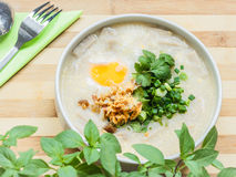 Rice soup with egg, herbs and meat. Stock Photos