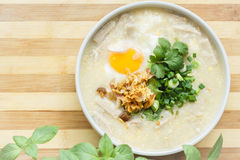 Rice soup with egg, herbs and meat. Stock Photo