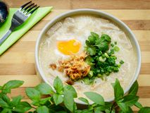 Rice soup with meat, egg and herbs Royalty Free Stock Image