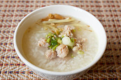 Rice soup with pork. In bowl Stock Photo