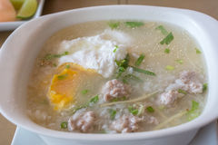 Rice soup with pork and egg boil with spoon set. Thai porridge with pork and egg for breakfast. Rice soup with pork and egg stock photography