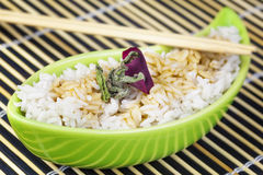 Rice with soy sauce in clay bowl Royalty Free Stock Image