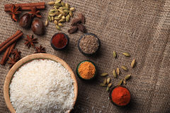 Rice and spices. Burlap background Stock Photo