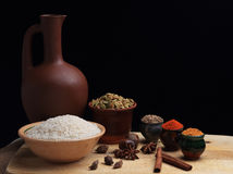 Rice and spices and the clay pitcher Stock Photography