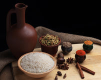 Rice and spices and the clay pitcher Royalty Free Stock Photography