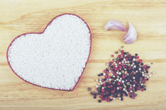 Rice and spices. In the form of heart Royalty Free Stock Image