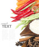 Rice, spices and fresh vegetables. (red chili, green beans, carrot) With sample text stock photography