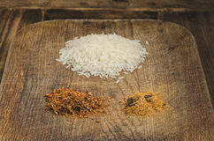 Rice and spices. Ingredients for healthy  food. Royalty Free Stock Photo