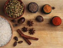 Rice and spices on the wooden board Royalty Free Stock Photography