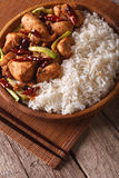 Rice with spicy kung pao chicken close-up. vertical Stock Images