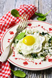 Rice with spinach and fried egg. Stock Image