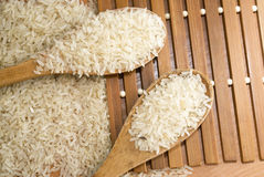 Rice in the spoon. Rice in the wooden spoon Royalty Free Stock Photo