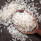 Rice in spoon Stock Photos