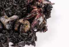 Rice with squid ink. Arroz negro, traditional Spanish seafood rice cooked with squid ink Royalty Free Stock Photography