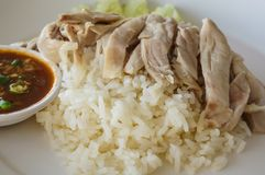 Rice steamed with chicken soup. Rice steamed in chicken broth. Poached chicken served with small portion of ginger and chili sauce Stock Photo